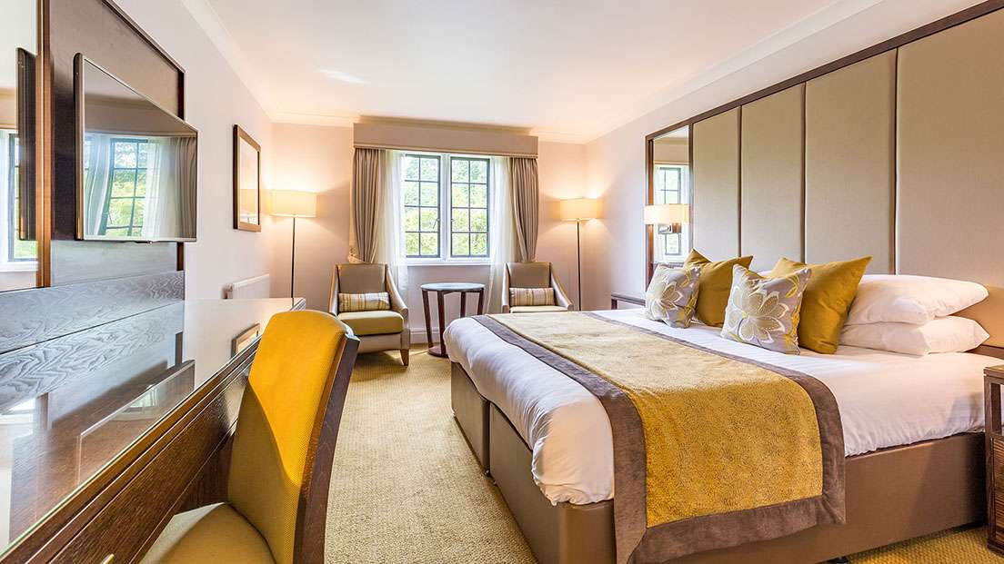 Classic Bedroom At Rhinefield House Hotel In Hampshire